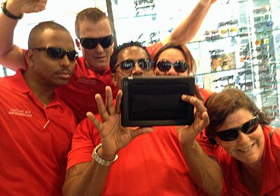 Team taking an iPad selfie during our Event Kick-Off SmartHunt® program