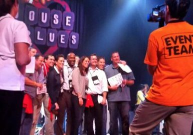 Team posing on stage during House of Blues® Celebrity SmartHunt®