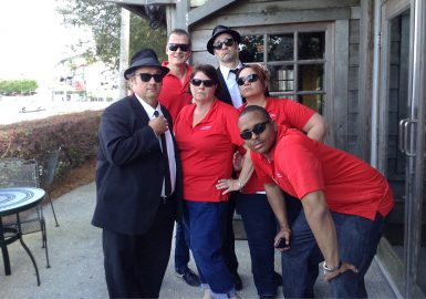 Team posing with Blues Brothers lookalikes during our House of Blues® Celebrity SmartHunt®