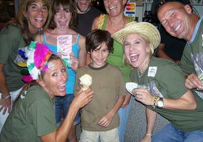 Locate and Donate SmartHunt® team with ice cream posing with child