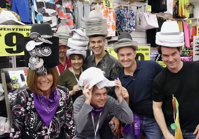 Locate and Donate SmartHunt® team posing with a stack of hats on