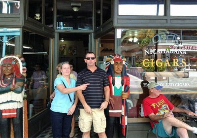 Locate and Donate SmartHunt® team posing in front of cigar store