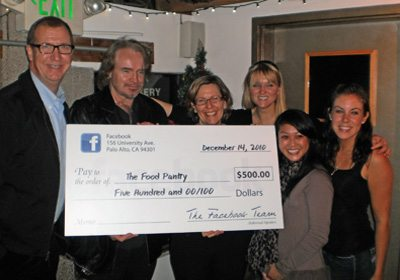 Picture of a Locate and Donate SmartHunt® team holding a check