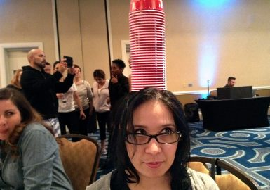 Stack of cups balanced on teammates head
