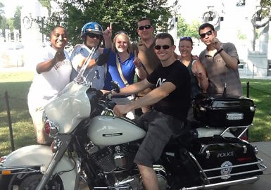 Team picture with motorcycle cop