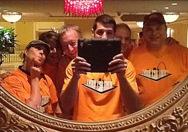 Team picture in mirror with iPad®