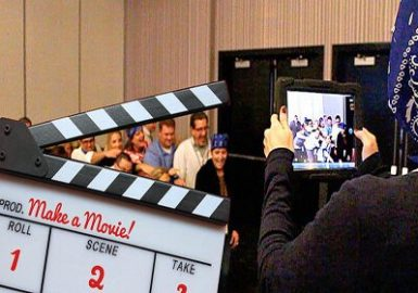 Picture with clapperboard graphic of participants being filmed with an iPad