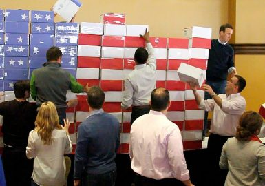 Teams creating the American Flag with Operation Military Care packages