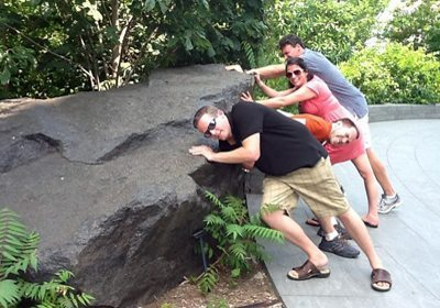 picture of team trying to push an unmovable rock during a City SmartHunt
