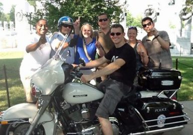 Picture of team posing by a motorcycle for a City SmartHunt