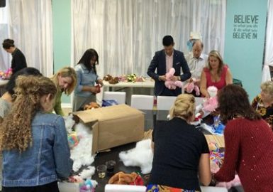 Group shot of participants stuffing their bears