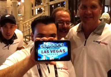 SmartHunt team with iPad® that says: Welcome to Fabulous Las Vegas