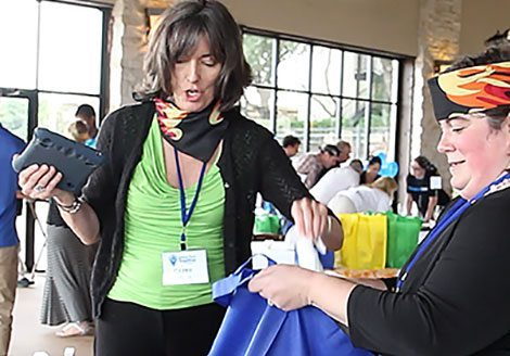teammate putting her hand in a We Care for Schools™ gift bags