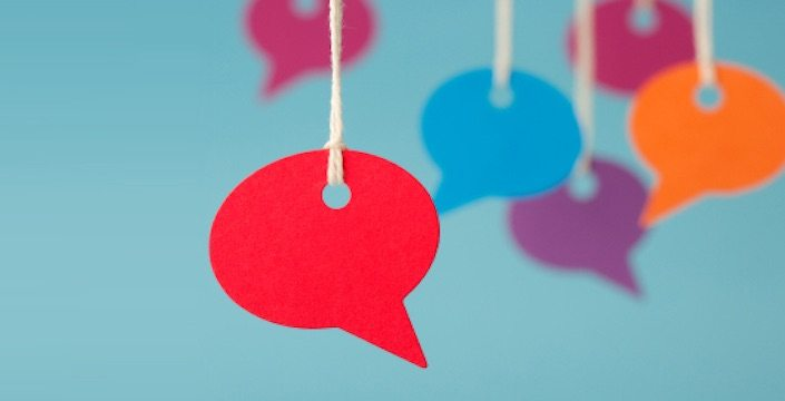 Photo of colored speech bubble hanging on string