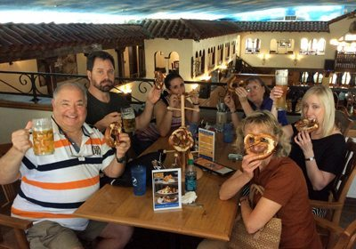 Team poses for photo with beer and pretzels during our Foodie SmartHunt® program