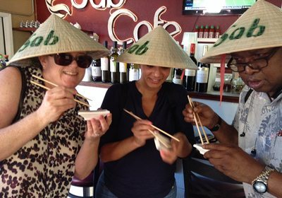 Team posing for photo with chopsticks during our Foodie SmartHunt® programs