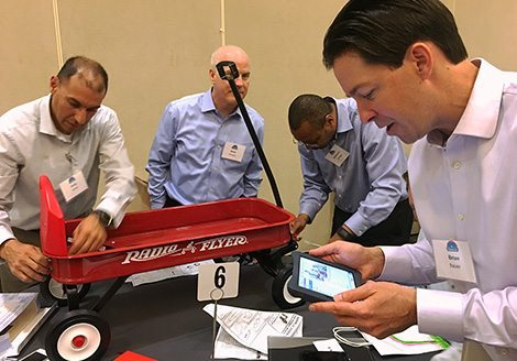 Team almost finished building Radio Flyer during Wagon Build Donation™ program