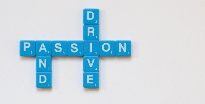 Scrabble pieces spelling out Passion and Drive
