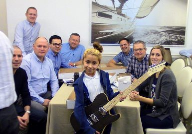 Team with happy guitar recipient