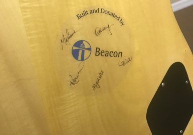 Signed sticker on back of guitar that says Built and Donated by Beacon