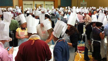 Team cooking with hats