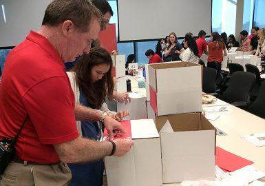 Team decorating boxes to donate