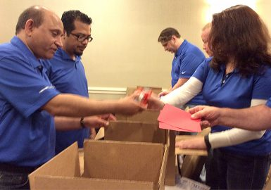 Team packing boxes for donation