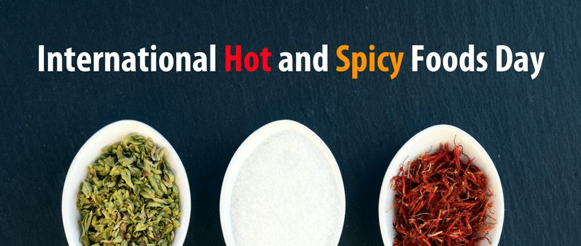 Graphic of the words International Hot and Spicy Foods Day with three spoons below it holding different spices
