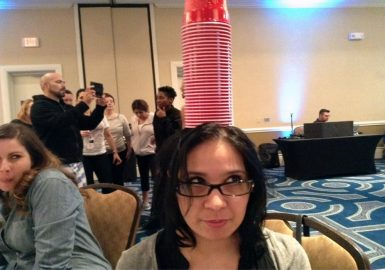 stack of cups on girls head